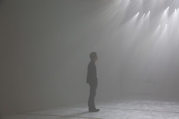 Designer Tokujin Yoshioka standing in the Twilight exhibition.