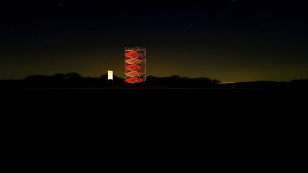 The tower is a graphic silhouette in the night.