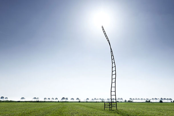 The empty chair by Marten Baas standing on a field