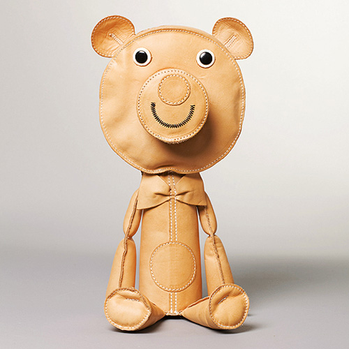A light brown leather toy from Acne JR