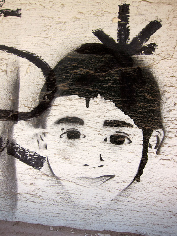 A street art face of a young boy