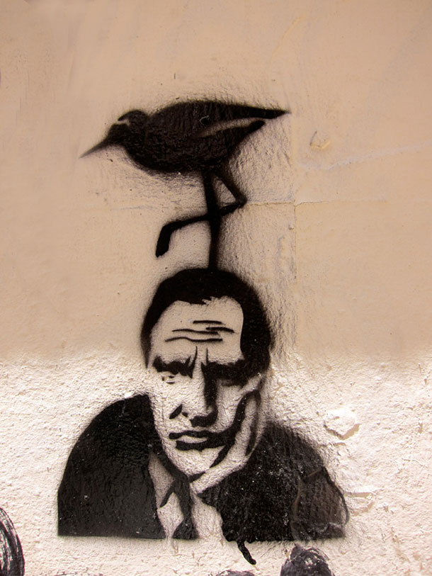 A wall painting showing a bird on a mans head