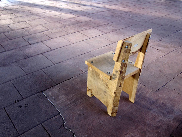 A small chair in wood for children by Piet Hein Eek