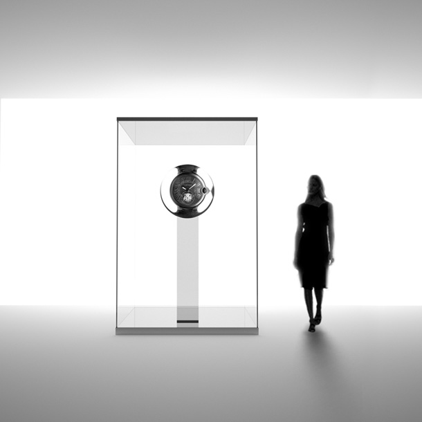 Female standing besides a clock at the Cartier Time Art exhibition