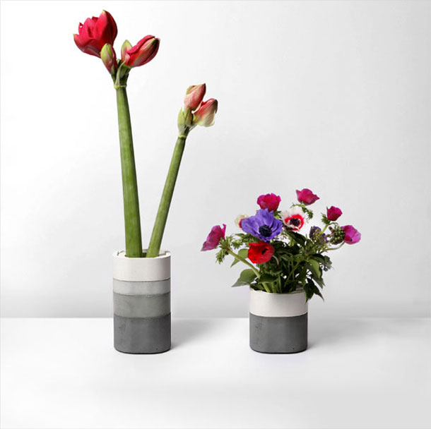 Two concrete vases with flowers