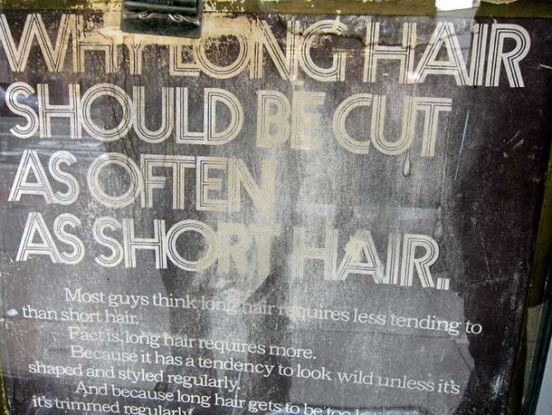 Sign in the window of a hair dresser