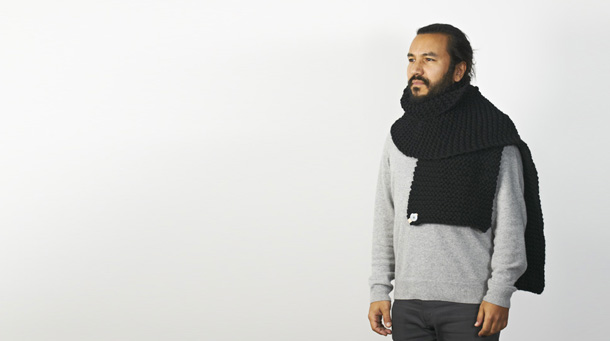 Hand knitted wool wrap on a person