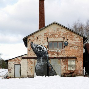 Urban artist ROA working on a show in Stockholm